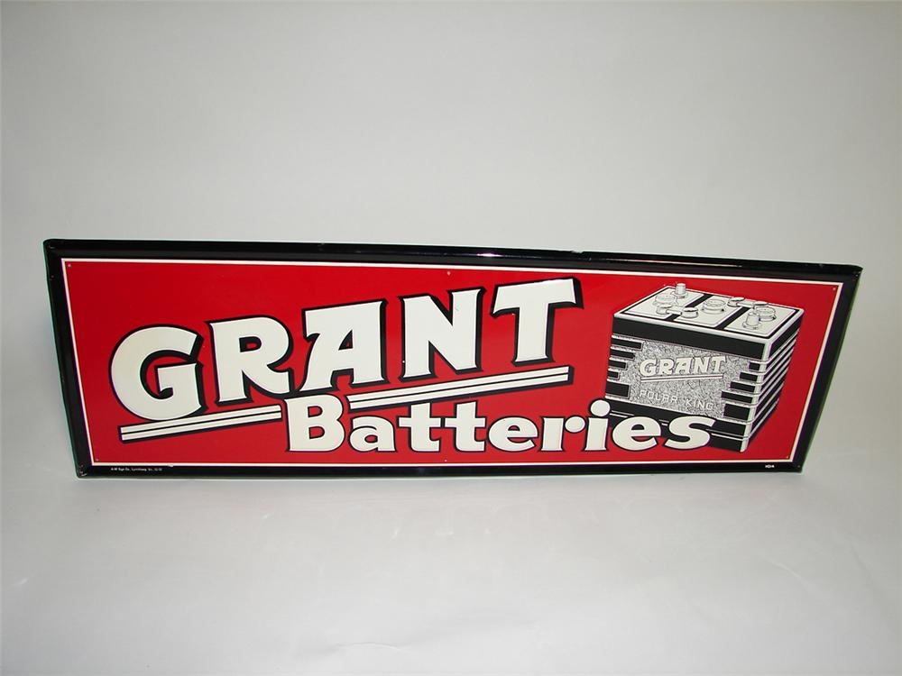 N.O.S. 1952 Grant Batteries single-sided embossed tin garage sign. - Front 3/4 - 101887