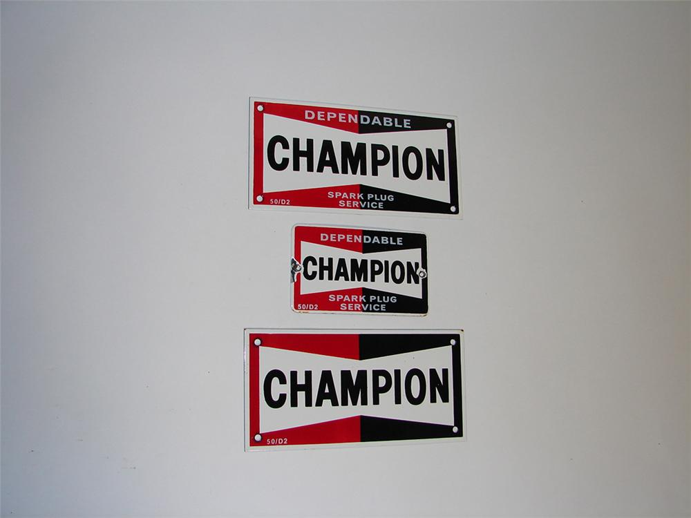 Set of three 1950 Champion Spark Plugs porcelain cabinet signs. - Front 3/4 - 101932