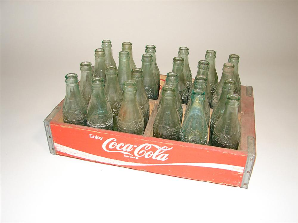 1950s wooden Coca-Cola crate filled with original hobble skirt Coke bottles. - Front 3/4 - 101947