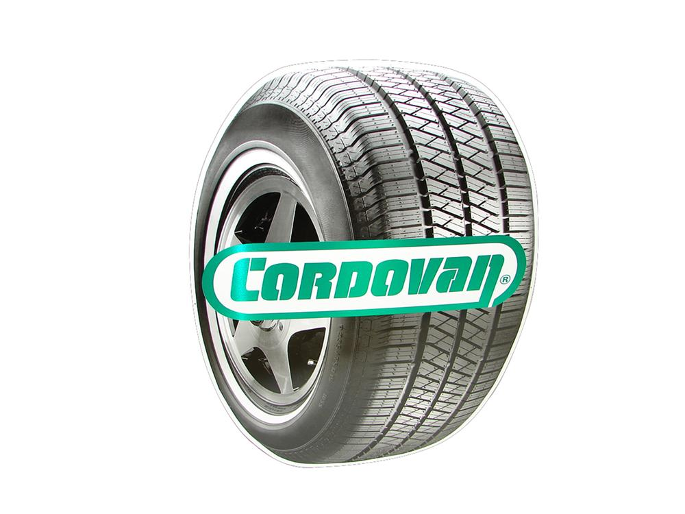 N.O.S. Cordovan Tires die-cut tin automotive garage sign. Pulled out of the original shipping paper! - Front 3/4 - 102230
