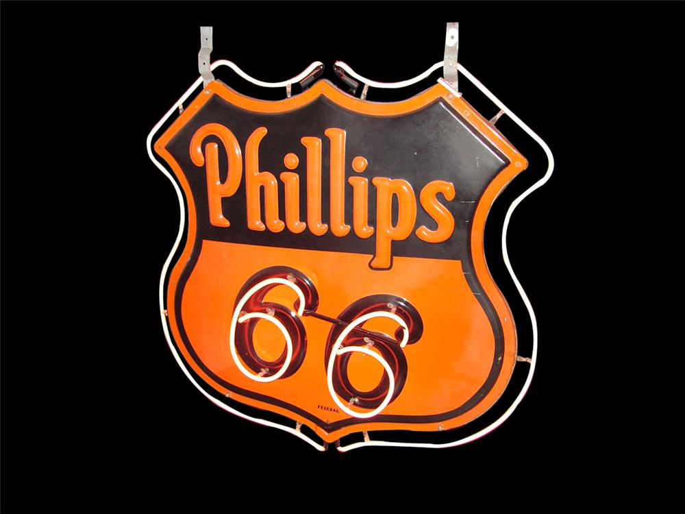 Extraordinary 1940s Phillips 66 shield shaped double-sided embossed porcelain neon service station sign. - Front 3/4 - 102245