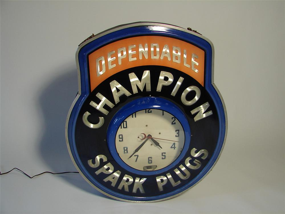 Extremely hard to find 1950s Champion Spark Plugs neon garage clock with embossed lettering. - Front 3/4 - 108341