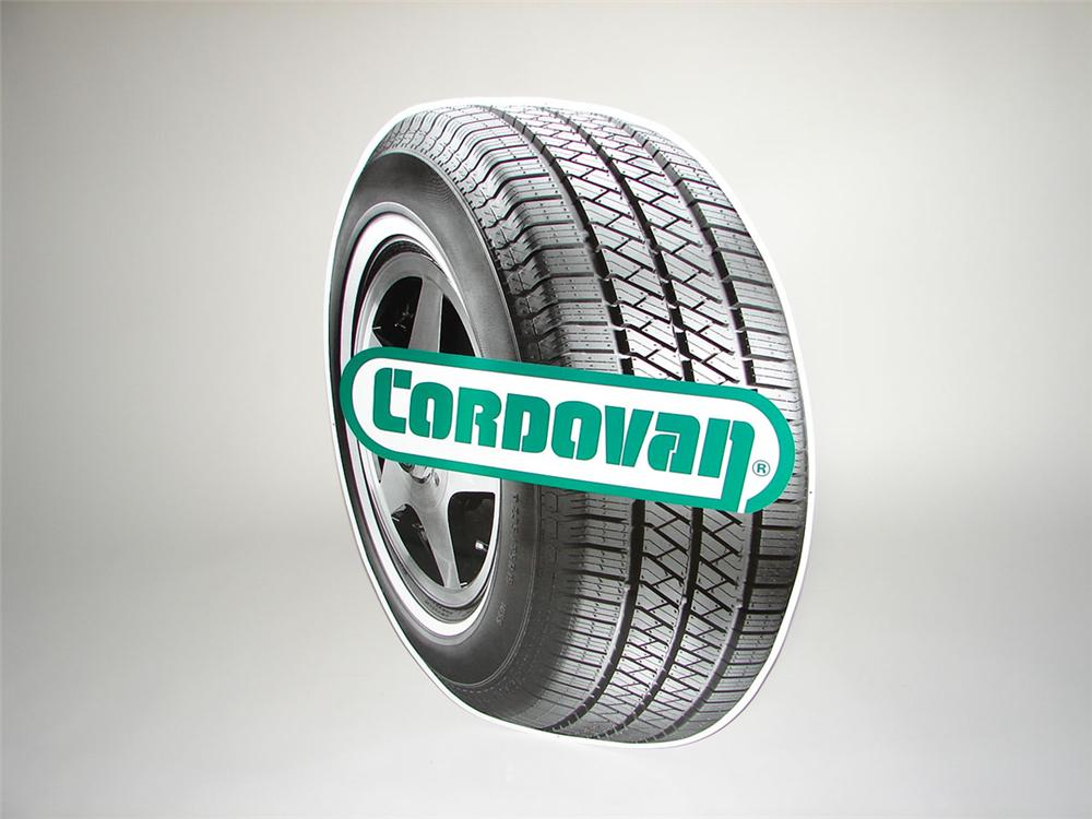 N.O.S. Cordovan Tires single-sided die-cut tin tire shaped garage sign. - Front 3/4 - 108347