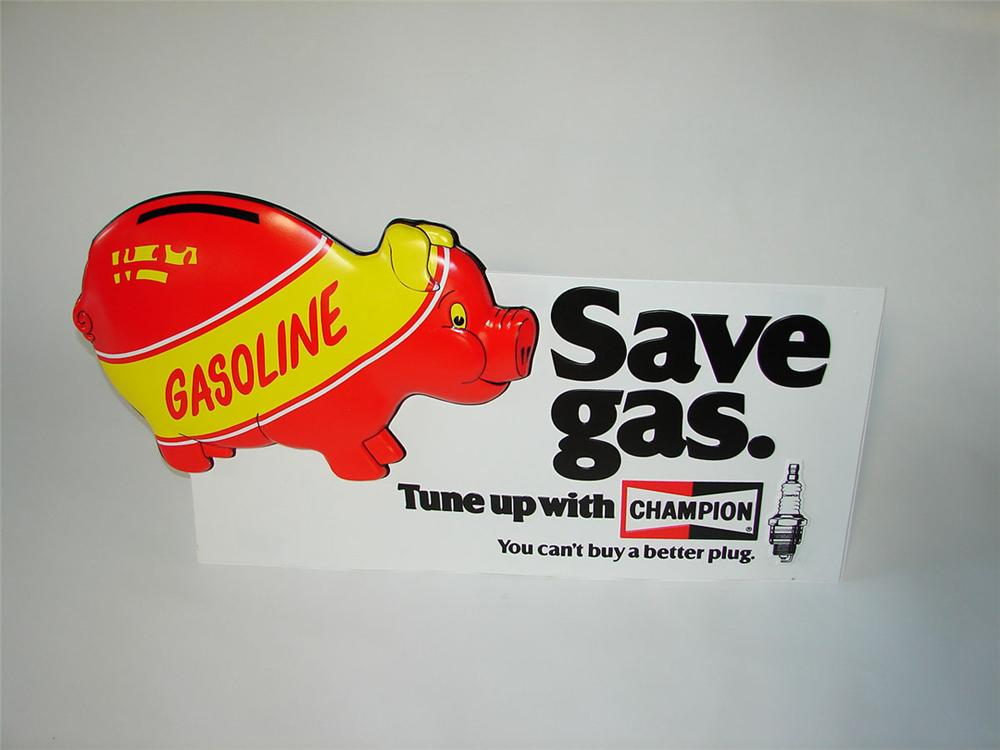 """N.O.S. early 1970s Champion Spark Plugs """"Save Gas"""" Piggy Bank motif three-dimensional plastic sign. - Front 3/4 - 108410"""
