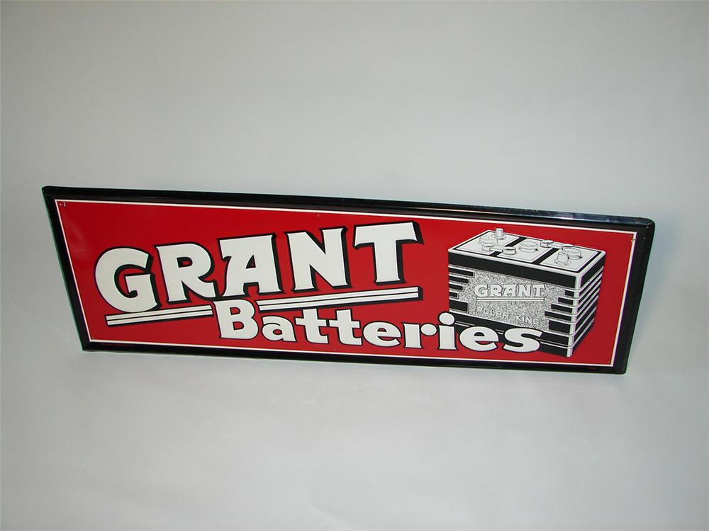 Striking N.O.S. 1954 Grant Batteries self-framed tin garage sign with outstanding battery graphic. - Front 3/4 - 108411