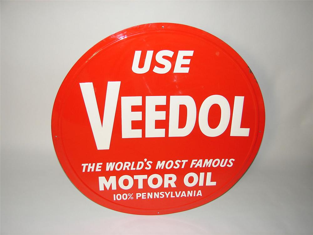 Seldom seen N.O.S. 1950s Use Veedol Motor Oil single-sided embossed tin garage sign. - Front 3/4 - 108571