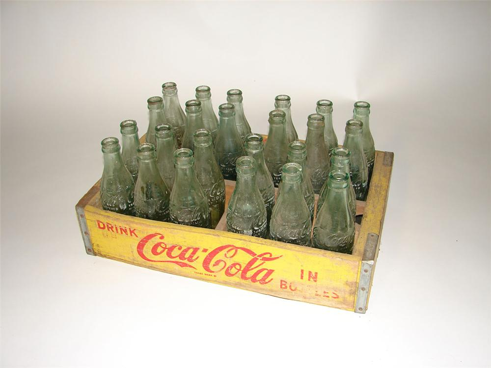 Neat 1950s Coca-Cola wooden bottle crate filled with original Coca-Cola embossed glass hobble skirt bottles. - Front 3/4 - 108599