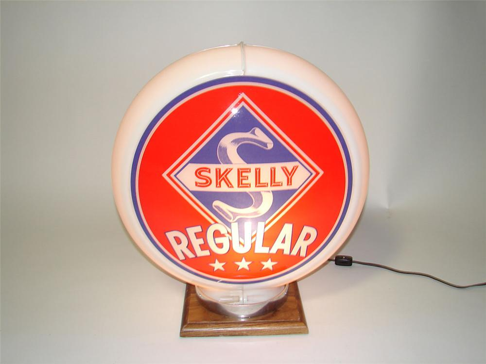 Superb N.O.S. 1950s Skelly Regular Gasoline glass lenses plastic bodied gas pump globe. - Front 3/4 - 108603