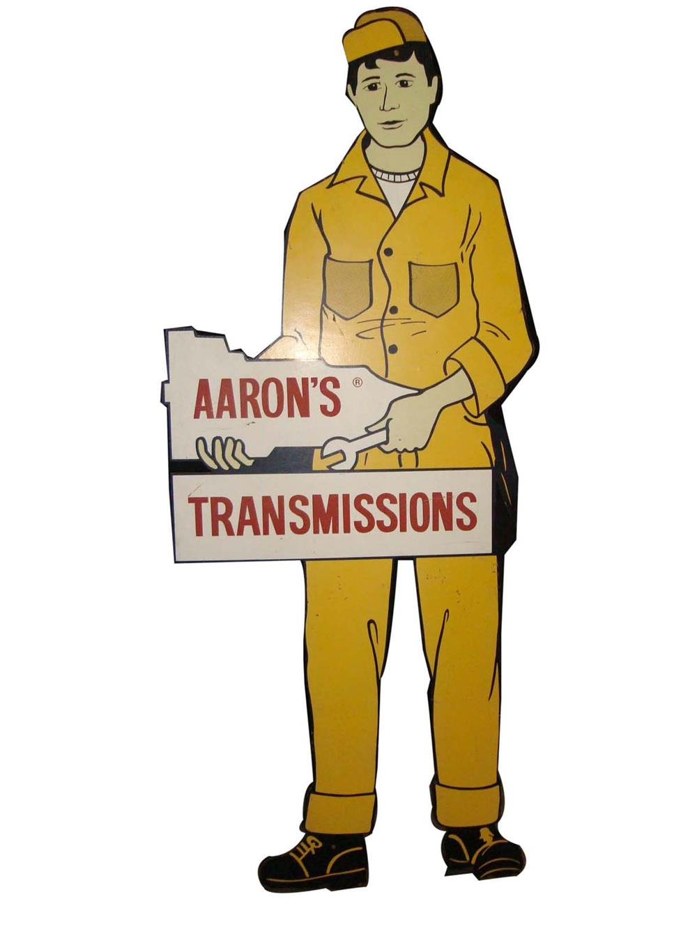 Phenomenal vintage Aaron Transmissions automotive garage sign die-cut with service attendant. - Front 3/4 - 108663