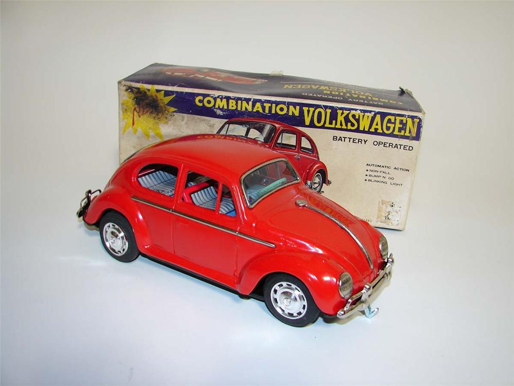 Very neat 1960s Volkswagen Beetle battery operated pressed steel toy car still in the original box. - Front 3/4 - 113030