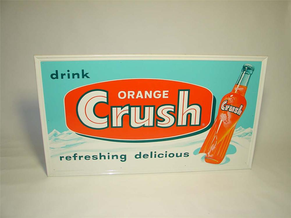 N.O.S. late 1950s-early 60s Orange Crush Soda self-framed tin sign with embossed bottle graphic. - Front 3/4 - 113042