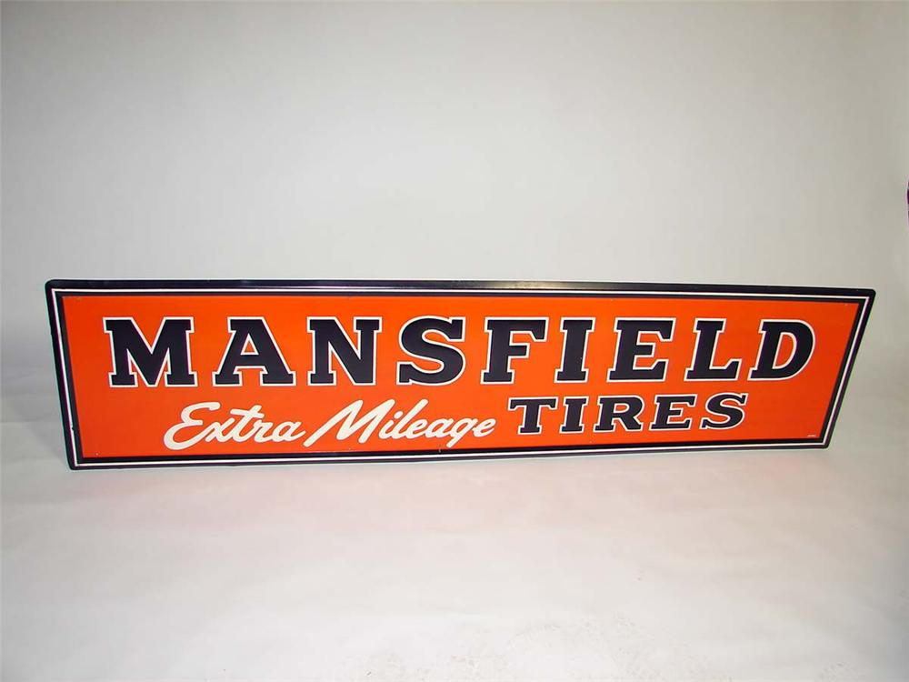 "Very clean N.O.S. 1947 Mansfield ""Extra Mileage"" Tires self-framed horizontal embossed tin garage sign. - Front 3/4 - 113047"
