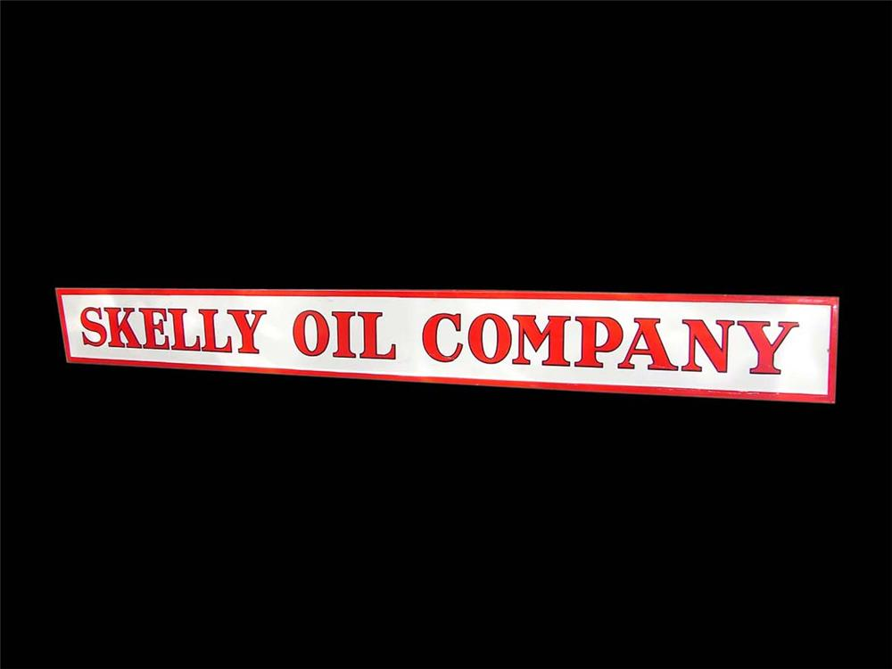 Very clean 1940s Skelly Oil Company horizontal self-framed porcelain service station sign. - Front 3/4 - 113138