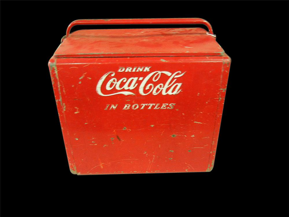Unrestored 1950s Coca-Cola metal picnic cooler with embossed logo. - Front 3/4 - 113191
