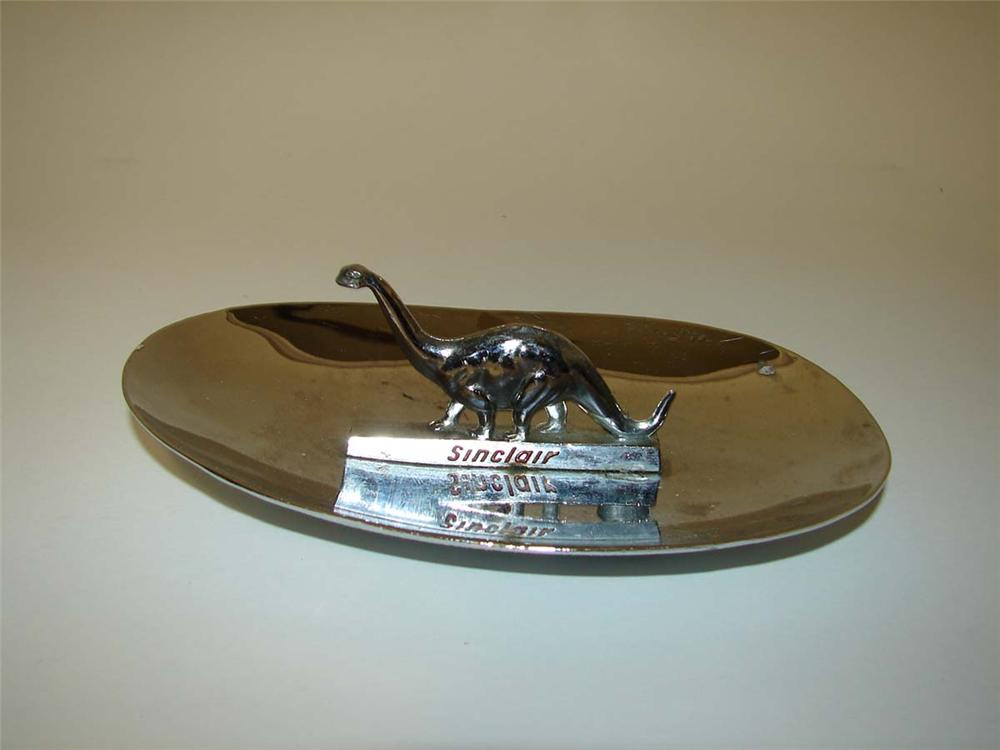 "1950s-60s Sinclair ""Go Dino"" service station chrome counter-top ash tray with three dimensional ""Dino"". - Front 3/4 - 113281"