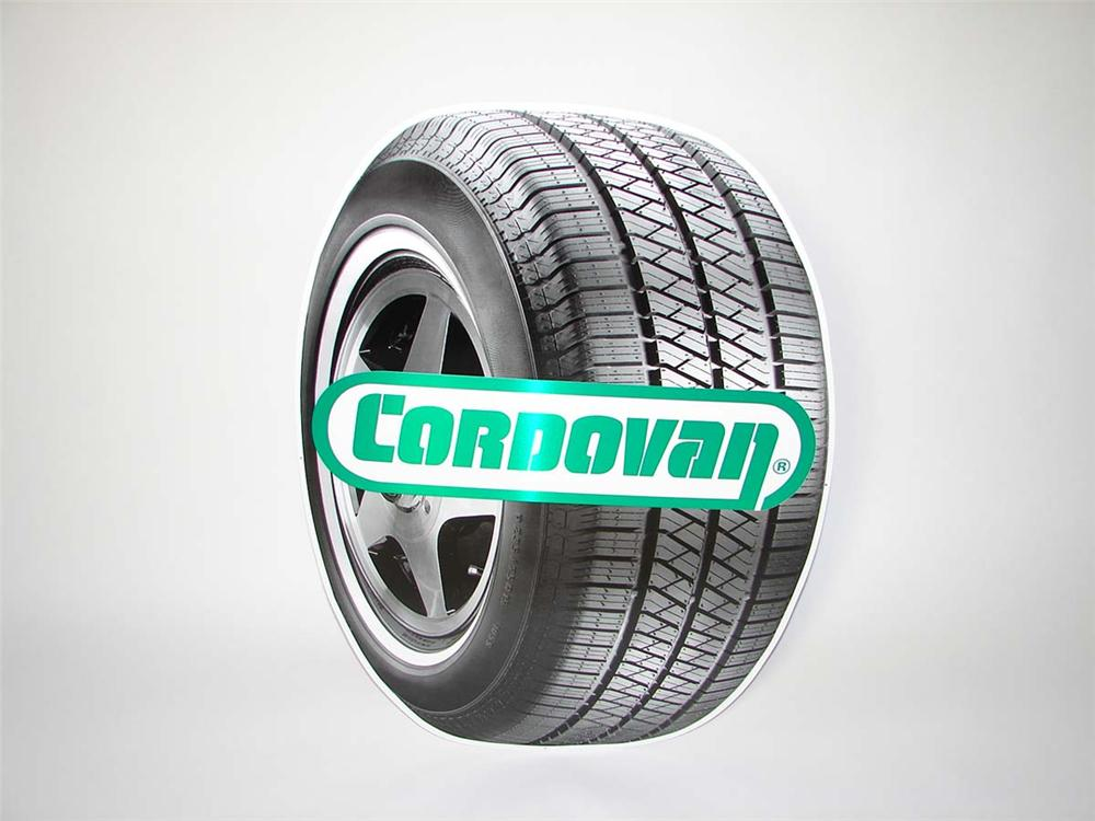 N.O.S. Cordovan Tires single-sided die-cut tire shaped tin garage sign. - Front 3/4 - 113321