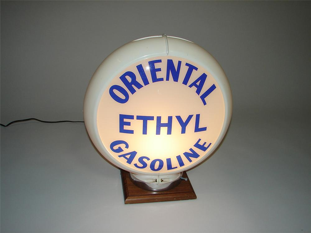 Unusual 1940s-50s Oriental Ethyl Gasoline gas pump globe with glass lenses in an original Capcolite body. - Front 3/4 - 113353