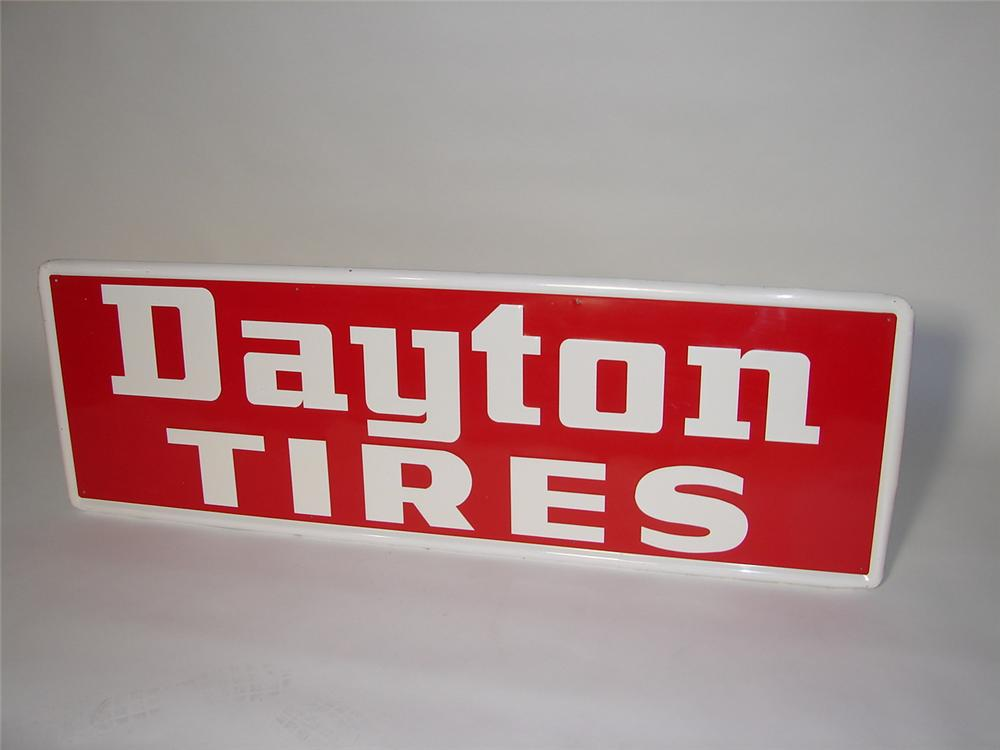 N.O.S. 1960s Dayton Tires horizontal tin garage sign with embossed lettering. - Front 3/4 - 116560