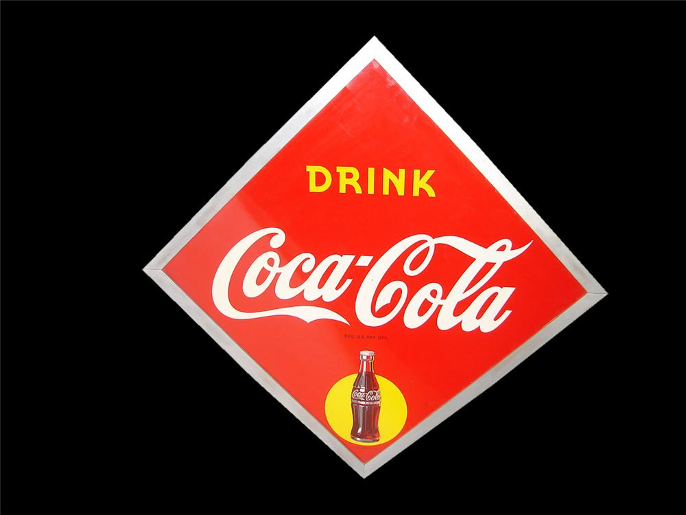 Spectacular N.O.S. 1953 Coca-Cola tin sign with Sunburst bottle graphic and wood frame. - Front 3/4 - 116577