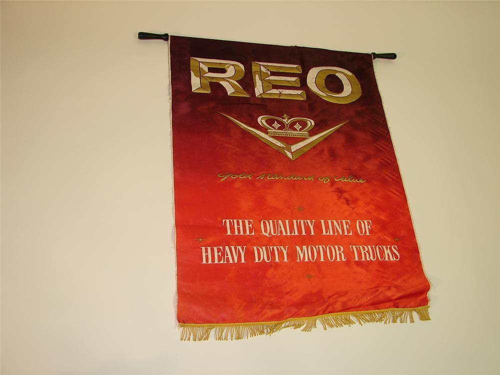 1940s REO Motor Trucks dealership showroom silk display banner. - Front 3/4 - 116616