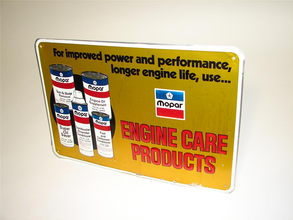 Nearly impossible to find 1960s Mopar Car Care Products single-sided embossed tin garage sign. - Front 3/4 - 116650