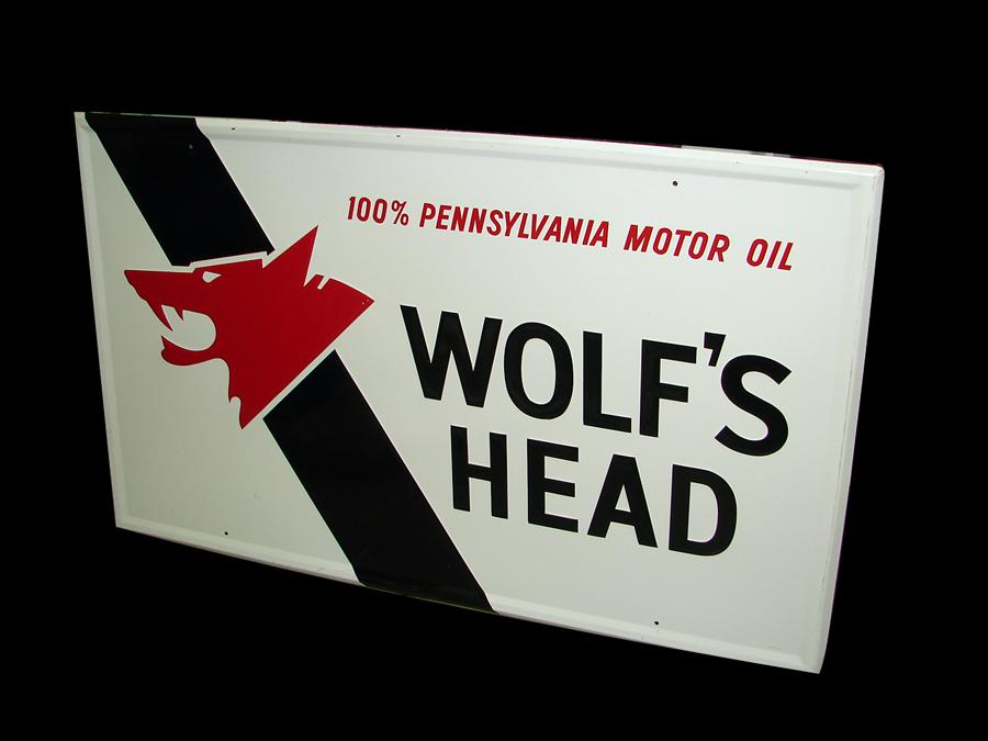 Large vintage Wolfs Head Motor Oil embossed tin garage sign with Wolfs Head logo. - Front 3/4 - 116669