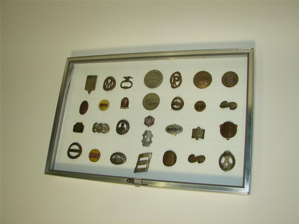 Impressive large display cabinet filled with turn of the century brass-era automotive badges. - Front 3/4 - 116676