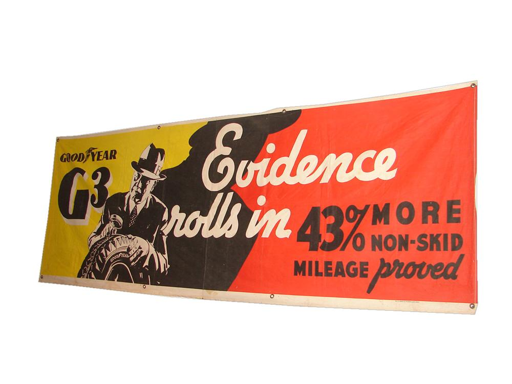 "1930s Goodyear Tires ""G-Man"" motif service station canvas banner with great graphics. - Front 3/4 - 116703"