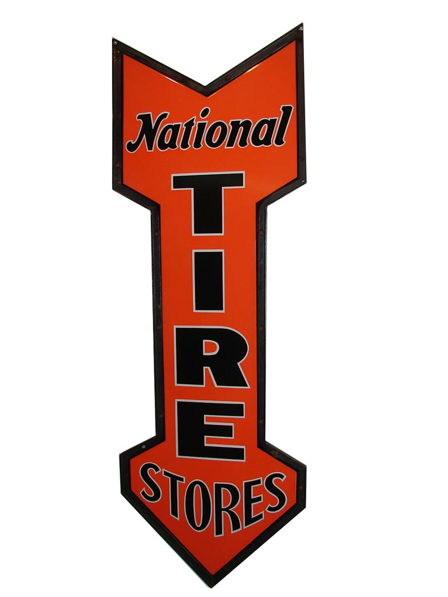 Nearly impossible to find N.O.S. 1930s National Tires Stores double-sided porcelain arrow shaped sign. - Front 3/4 - 116714