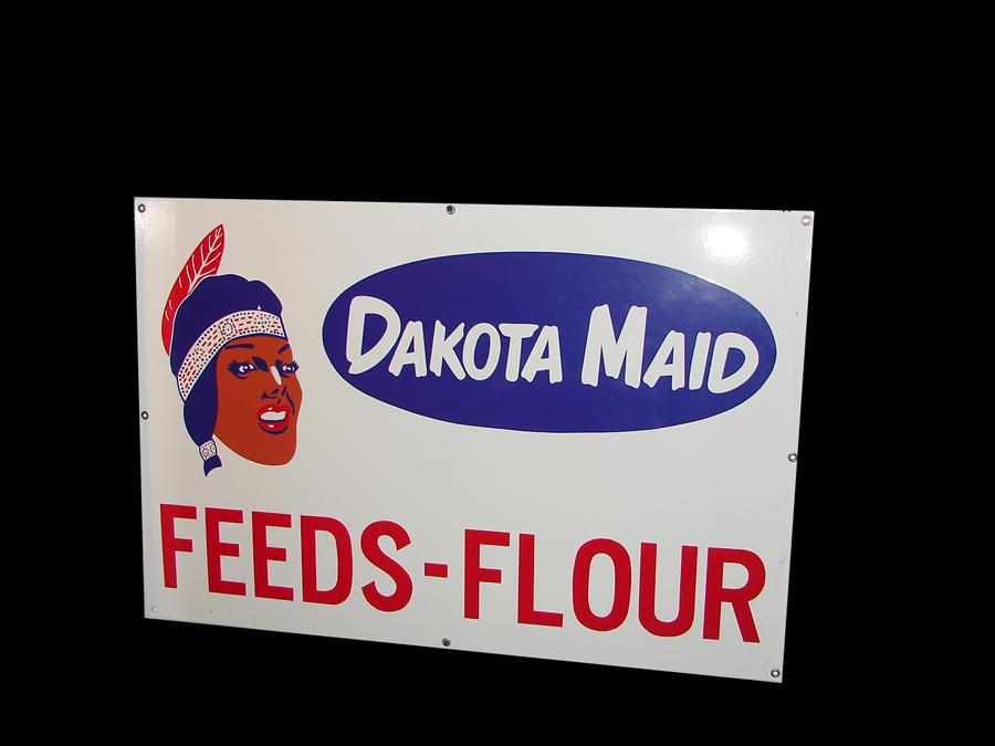 Choice N.O.S. 1950s Dakota Maid Feeds-Flour single-sided porcelain general store sign with Indian Maiden graphic. - Front 3/4 - 116721