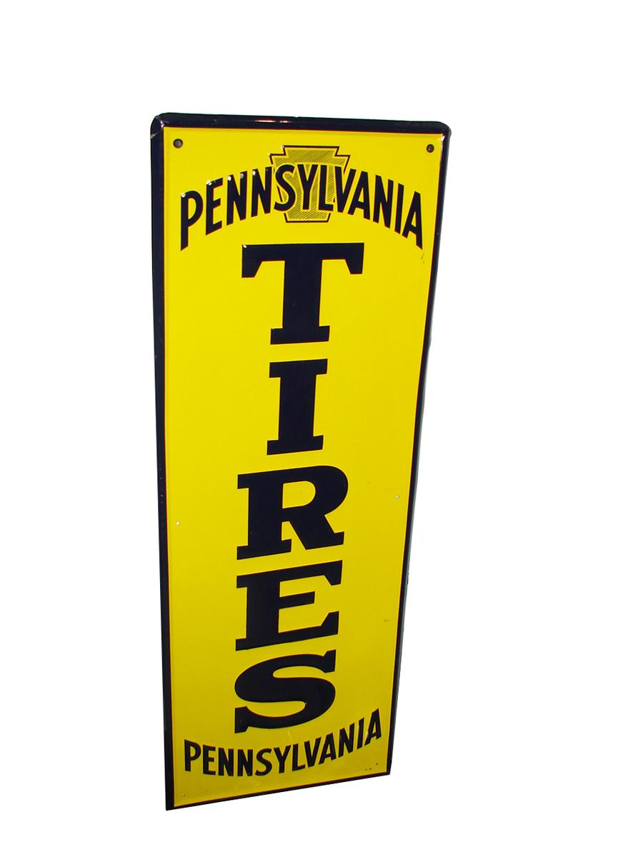 N.O.S. 1940s Pennsylvania Tires vertical embossed tin garage sign. Appears to have never been used. - Front 3/4 - 116722