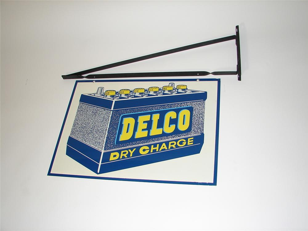 N.O.S. 1950s Delco Dry Charge Batteries double-sided tin garage sign with hanging bracket. - Front 3/4 - 116746