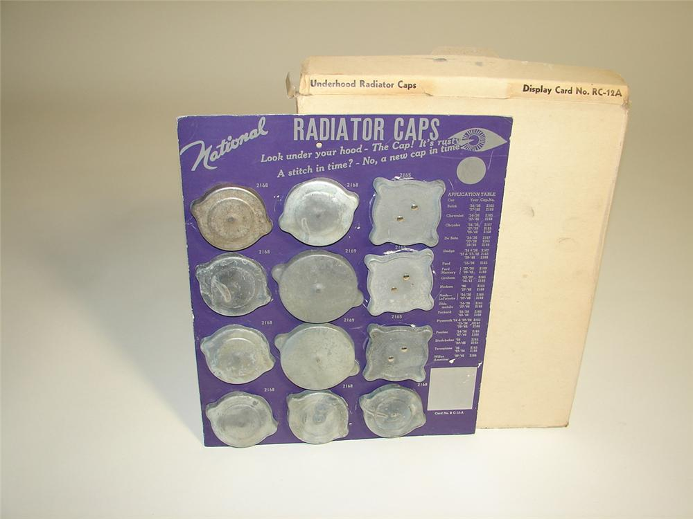N.O.S. 1940s National Radiator Caps automotive garage cardboard display still filled with original N.O.S. caps. - Front 3/4 - 116911