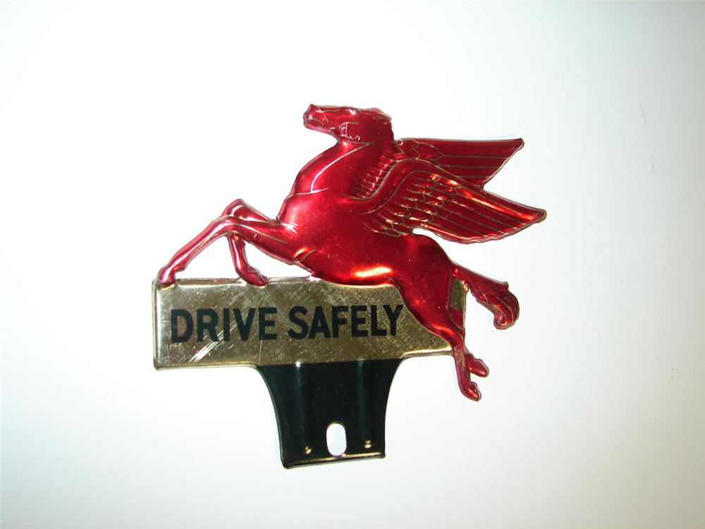 """N.O.S. 1930s Mobil """"Drive Safely"""" embossed die-cut license plate attachment sign featuring the iconic Pegasus. - Front 3/4 - 116916"""