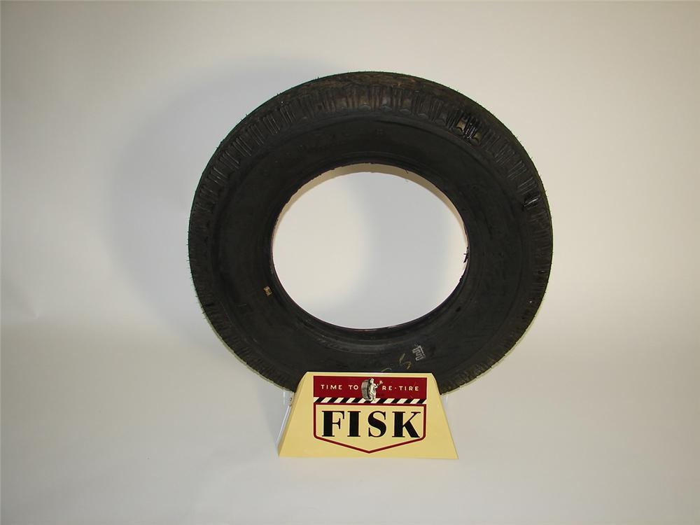 Choice 1940s Fisk Tires service station metal tire display with tire. - Front 3/4 - 116934