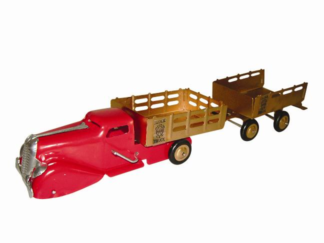 "1930s Louis Marx stake block dump truck and trailer. Professionally restored to original. Size 20"" in length. - Front 3/4 - 116970"