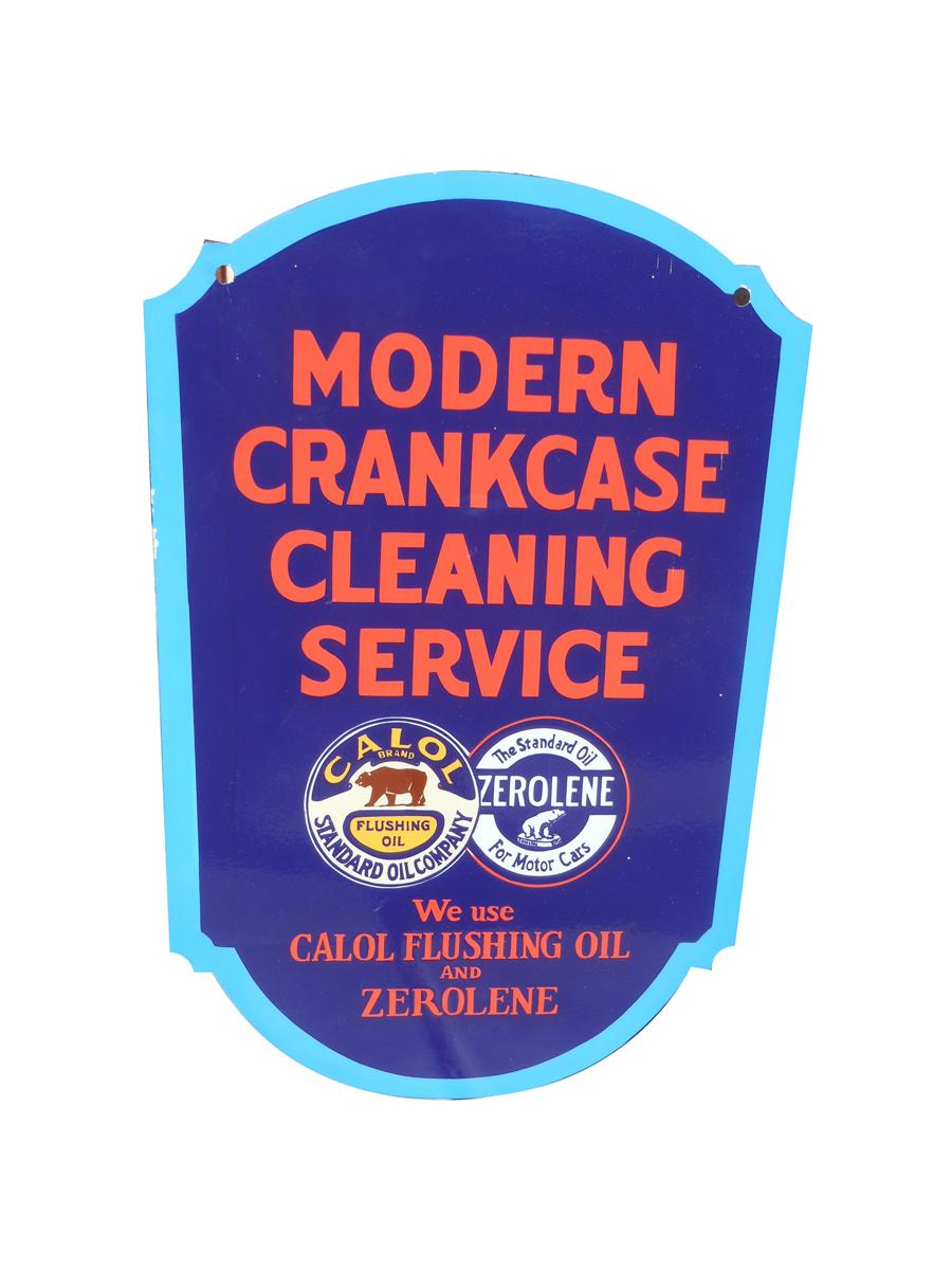 "Highly desirable 1930s Standard Oil die-cut porcelain ""Modern Crankcase Cleaning Service"" seven color flange . Underwent a p... - Front 3/4 - 116991"