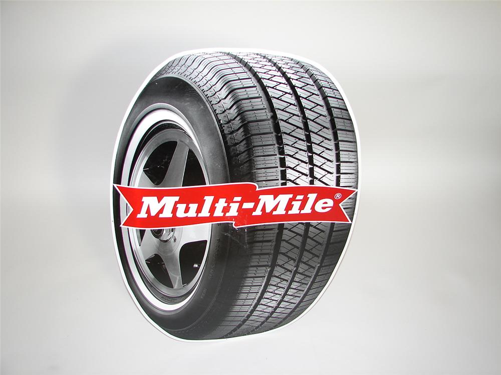 N.O.S. Multi-Mile Tires die-cut tin tire-shaped single-sided garage sign. - Front 3/4 - 117909