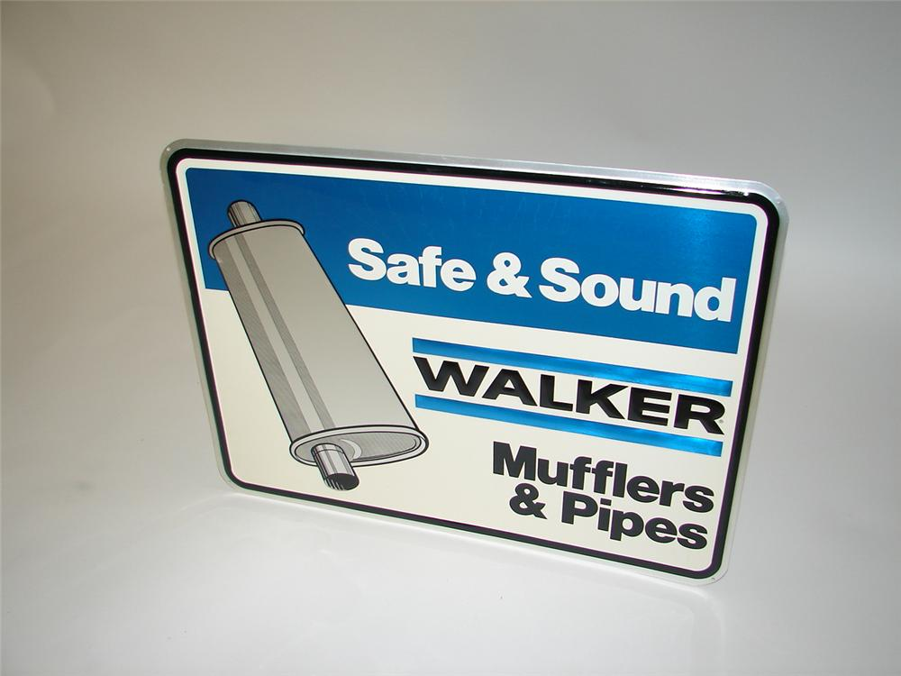 N.O.S. Walker Mufflers embossed tin garage sign with muffler graphic. - Front 3/4 - 117911
