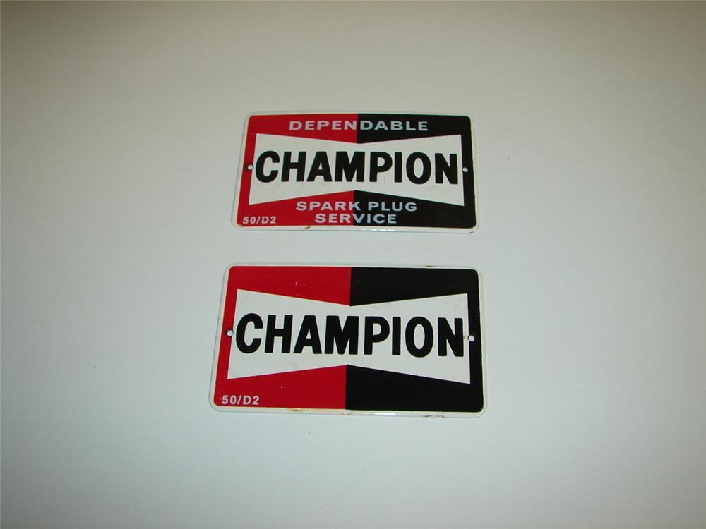 N.O.S. set of two 1950s Champion Spark Plugs cabinet signs. - Front 3/4 - 117928