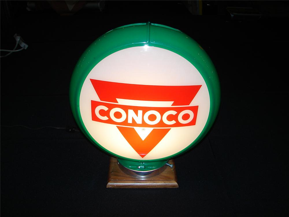 Choice 1950s Conoco Gasoline glass lensed gas pump globe in capcolite body. - Front 3/4 - 120655