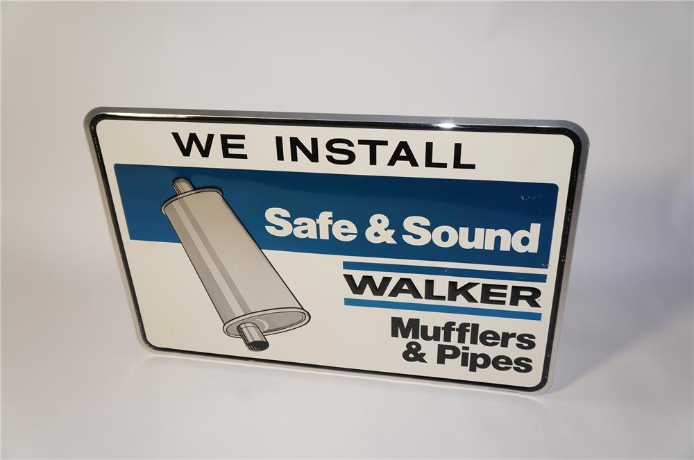 Nice N.O.S. Walker Mufflers Safe and Sound single-sided embossed tin garage sign with muffler graphic. - Front 3/4 - 125436