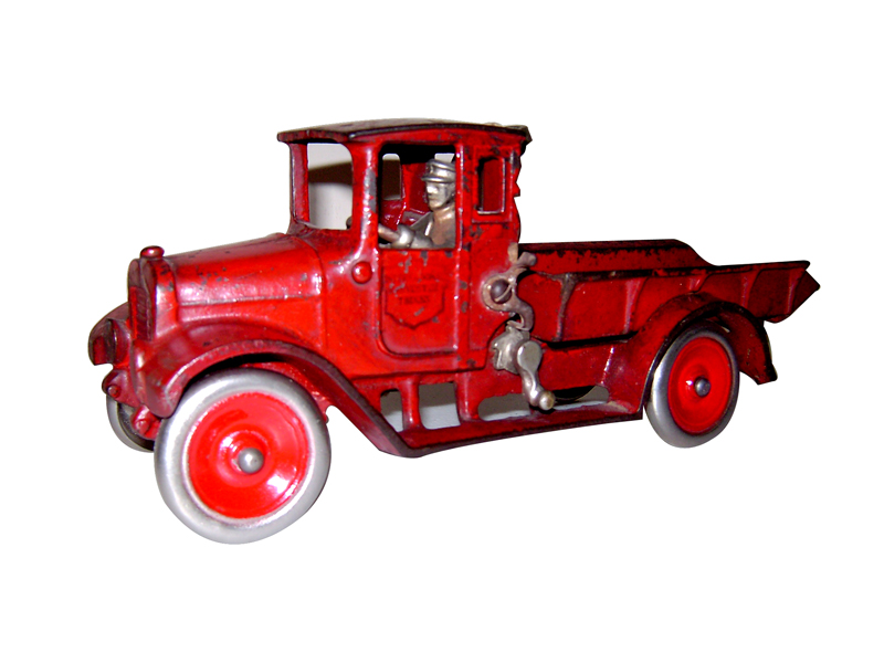 """Hard to find 1923 Arcade cast iron International Harvester """"Red Baby"""" dump truck with original driver. - Front 3/4 - 125649"""
