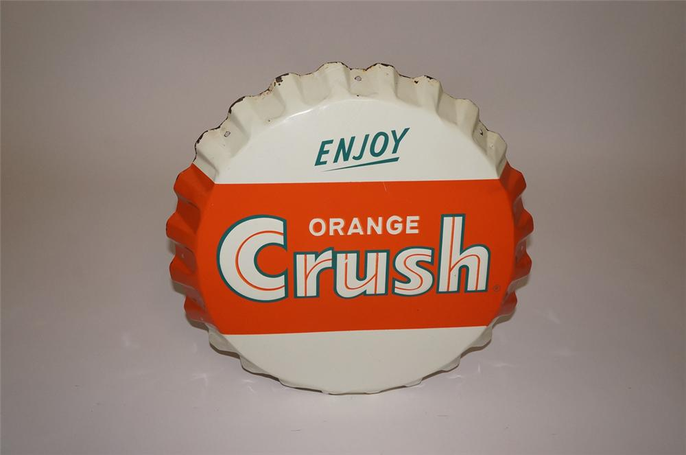 Neat 1950s Enjoy Orange Crush bottle-cap shaped embossed tin sign. - Front 3/4 - 130513