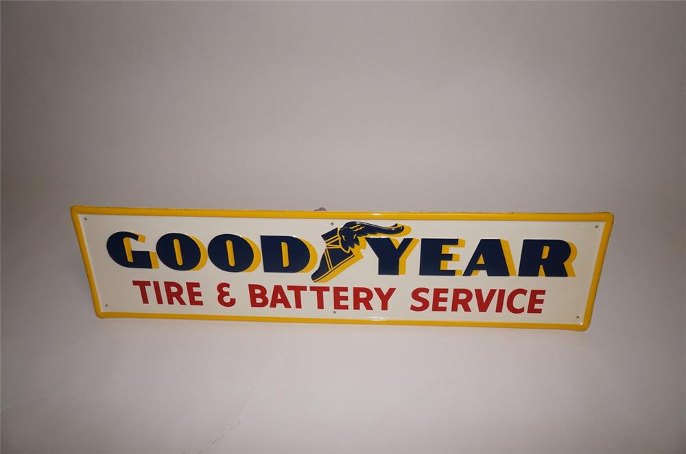 Superb N.O.S. 1950s Goodyear Tire and Battery Service horizontal embossed tin garage sign. - Front 3/4 - 130593