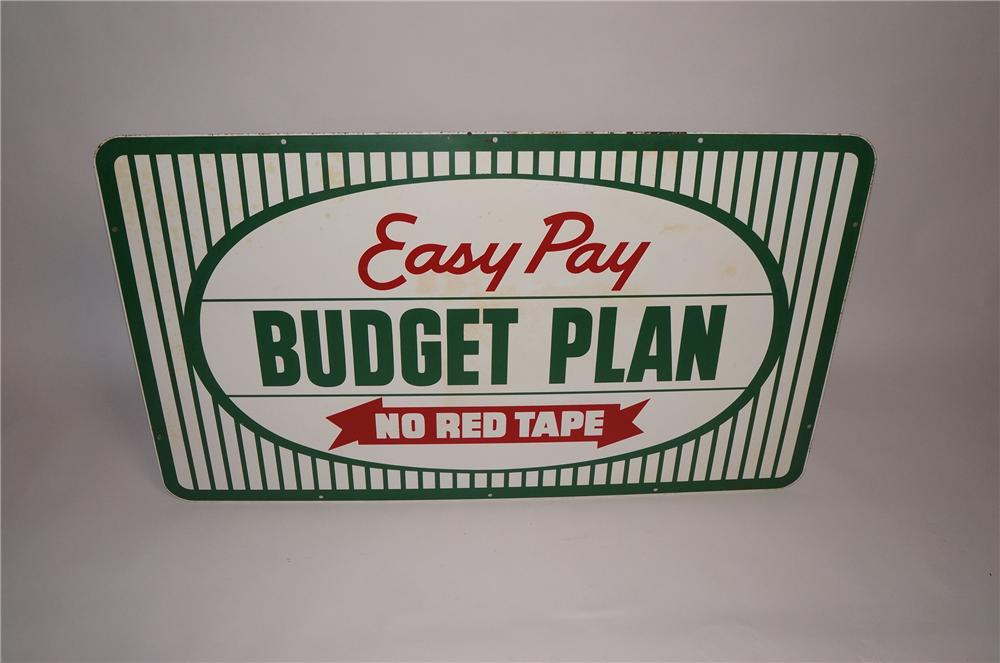"Interesting 1960s Kelly Tires ""East Pay - No Red Tape"" single-sided tin automotive garage sign. - Front 3/4 - 130749"