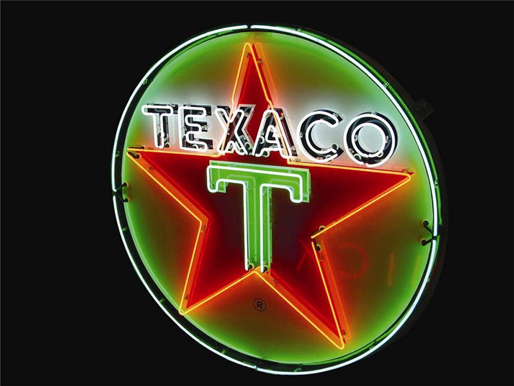 Outstanding 1940s-50s Texaco Service Station single-sided porcelain station sign with animated neon. - Front 3/4 - 130799