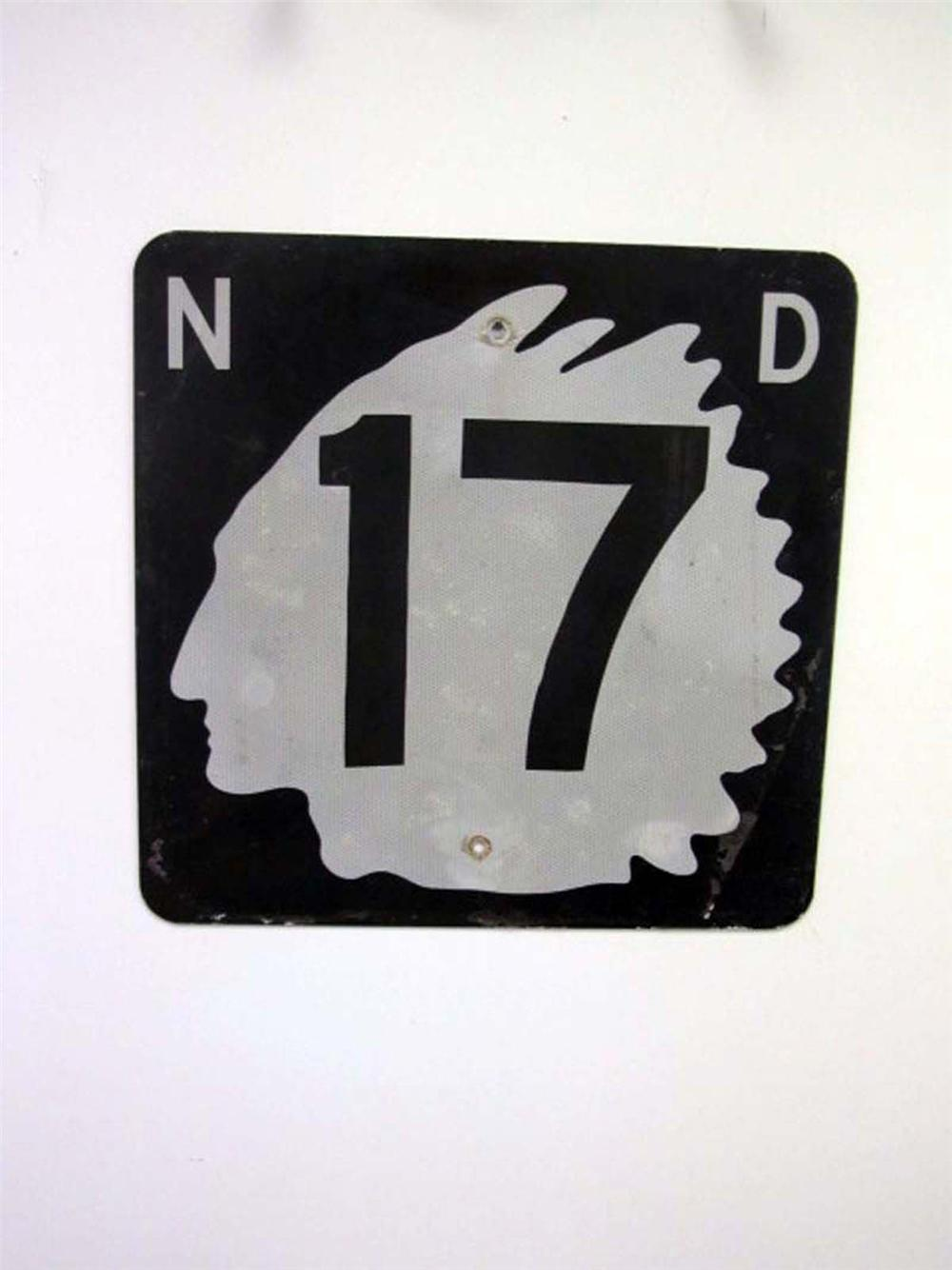 Fantastic vintage 1950s North Dakota Highway #17 metal road sign with Native American Chieftain logo. - Front 3/4 - 130831