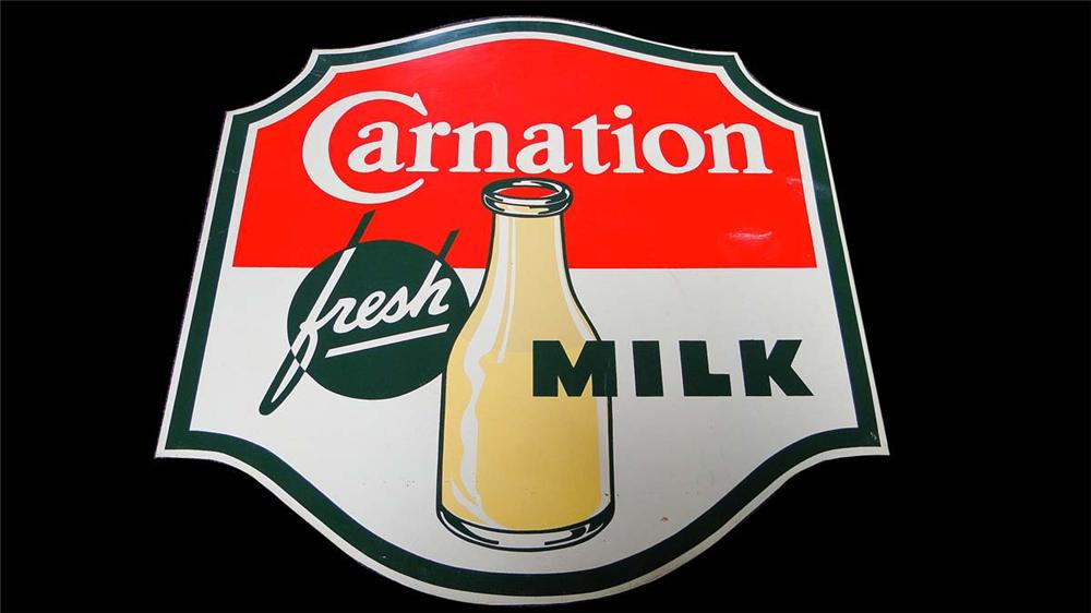 Very clean 1950s Carnation Milk single-sided tin general store sign with nice graphics and colors. - Front 3/4 - 130839