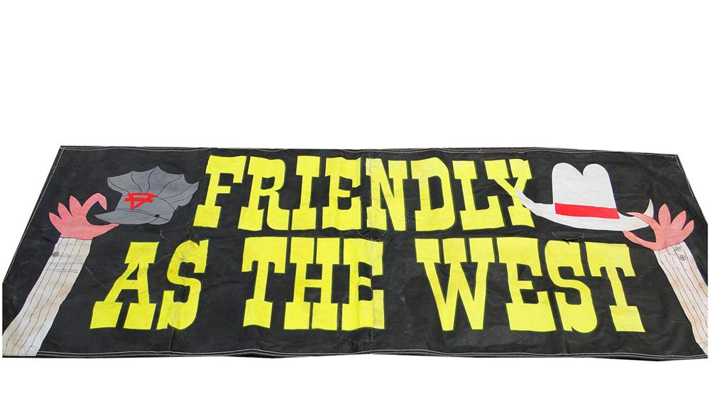 "Vintage large Conoco Oil ""Friendly as the West"" canvas service station banner. - Front 3/4 - 130848"